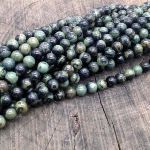 Riolite pallina 6 mm liscia - filo 62 pezzi